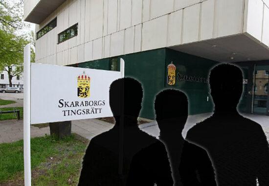 Skaraborgs tingsrätt med tre siluetter framför byggnaden